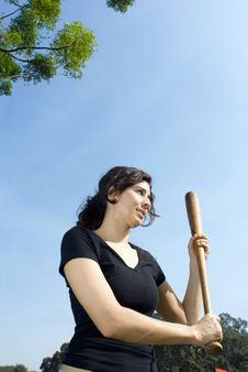 Woman Holding A Baseball Bat At Park - Vertically Royalty Free Stock Photos