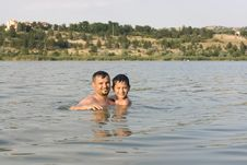 Free Man And His Son  In The Water Royalty Free Stock Photo - 5610875