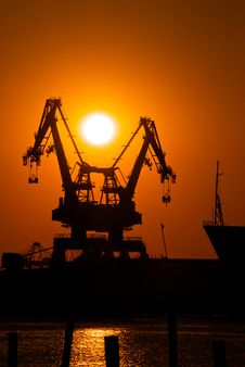Industrial Cranes At Sunset Royalty Free Stock Image