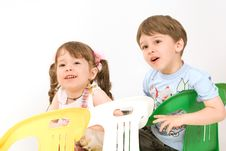 Free Adorable Children Sitting On Colorful Chairs Stock Images - 5613064