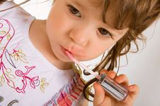 Free Adorable Little Girl Applying Make-up Royalty Free Stock Photos - 5613718