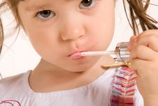 Free Adorable Little Girl Applying Make-up Royalty Free Stock Photos - 5613788