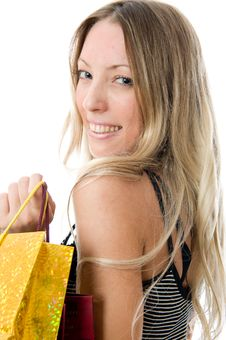 Free Happy Young Girl Holding Bags Royalty Free Stock Images - 5615649