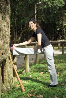 Free Woman Stretching Her Leg By A Tree - Vertica Stock Image - 5615791