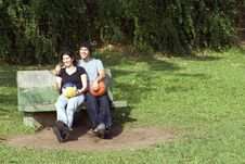 Man And Woman Sitting On A Bench - Horizontal Royalty Free Stock Photography