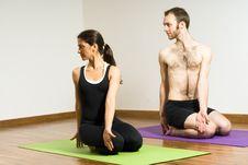 Man And Woman Performing Yoga - Horizontal Stock Photo