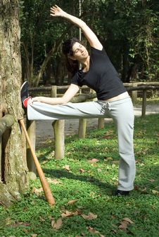 Free Woman Stretching With Baseball Bat - Vertica Royalty Free Stock Photo - 5616055