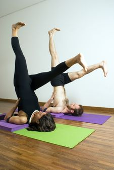 Man And Woman Performing Yoga - Vertical Stock Images