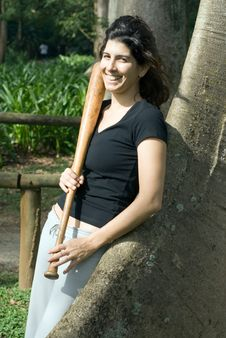 Free Woman Leaning Against Tree With Baseball Bat Royalty Free Stock Photos - 5616158