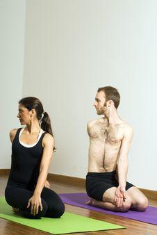 Man And Woman Performing Yoga - Vertical Stock Photos
