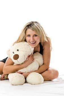 Free Lovely Young Blonde Girl With Teddy Bear Royalty Free Stock Photography - 5616747