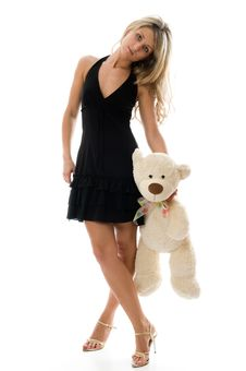 The Young Charming Girl Plays With A Bear Stock Image
