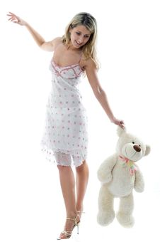 The Young Charming Girl Plays With A Bear Stock Photos