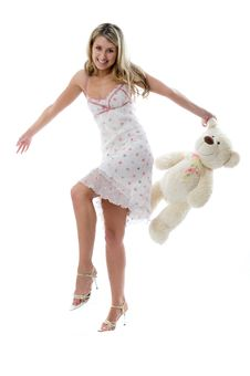 The Young Charming Girl Plays With A Bear Stock Images