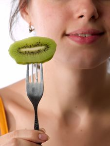 Free Beautiful Lady Eats Kiwi Stock Photos - 5621363