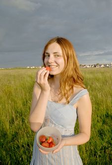 Free Girl With Strawberry On Meadow Royalty Free Stock Images - 5622229