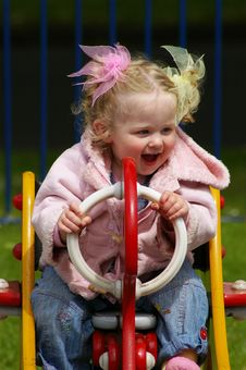 Free Happy Girl Playing In Park Stock Photos - 5622443
