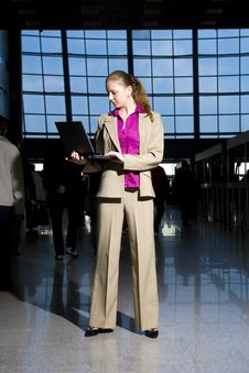 Young Girl With A Laptop In A Business Centre Stock Image