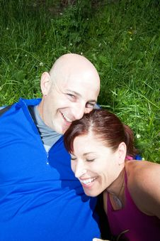 Free Happy Couple Sitting On The Grass  - Vertical Stock Images - 5624604