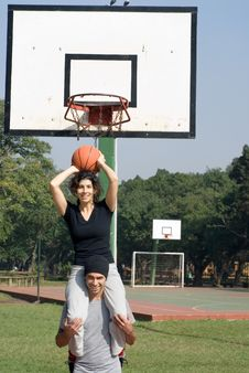 Woman On Man S Shoulders Playing Basketball Royalty Free Stock Photography