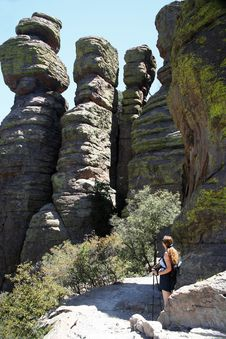 Free A Hiker Dwarfed By  Standing Up Rocks  Royalty Free Stock Images - 5626279