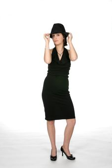 Slim Teen In Black Dress Wearing A Top Hat Royalty Free Stock Photography