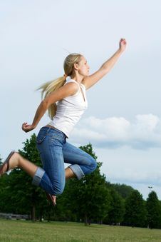 Free Jumping Woman. Royalty Free Stock Photography - 5628647