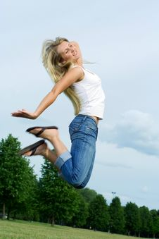Free Happy Jumping Woman. Royalty Free Stock Photography - 5628657