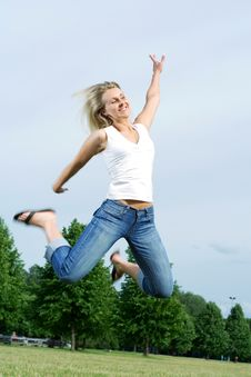 Free Happy Jumping Woman. Stock Images - 5628674