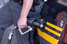 Free Sheriff Pumping Gas Stock Photos - 5630803
