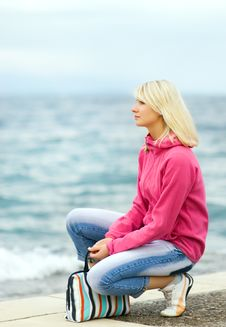 Free Woman Sitting Near The Ocean Stock Photos - 5631533