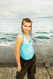 Free Girl Standing Near The Ocean Stock Photos - 5631563