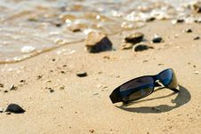 Glasses Laying On Sea Coast Stock Images