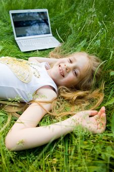 Free Smiling Little Girl With Laptop Outside Stock Photos - 5632993