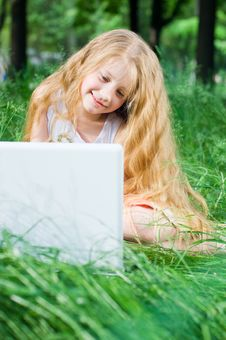 Free Serious Looking Little Girl With Laptop Royalty Free Stock Photos - 5633088
