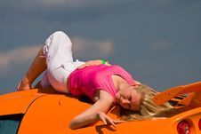 A Female Model Laying On A Car Royalty Free Stock Images