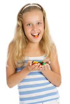 Free Young Smiling Girl With Chocolate Candy Stock Photos - 5634793