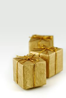 Free Three Golden Gift Boxes Royalty Free Stock Photography - 5634897