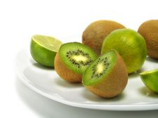 Plate Of Kiwis And Limes Stock Images