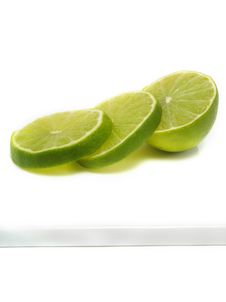 Free Sliced Fresh Lime On Cutting Board Royalty Free Stock Image - 5635536