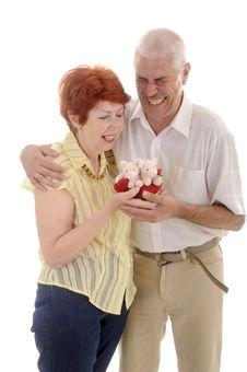 Free Senior Couple With Pig Toy Royalty Free Stock Photos - 5636188