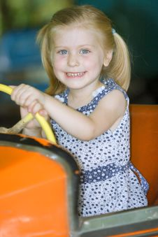 Free Little Cute Girl Having Fun Royalty Free Stock Image - 5637396