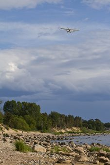 Plane In The Sky Above The Sea Coast Royalty Free Stock Photography