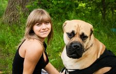 Young Blond Woman With Her Dog Stock Image