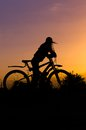 Free Silhouette Of A Gerl With A Bicycle Against The Sky At Sunset, Stock Photography - 56390012