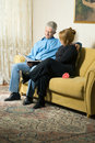 Free Couple Reading A Book On A Couch-Vertical Royalty Free Stock Image - 5640546