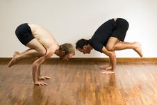 Two Men In A Yoga Crouch - Horizontal Royalty Free Stock Photo