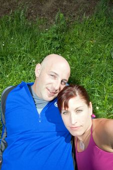 Free Couple Sitting On The Grass  - Vertical Stock Photos - 5640703