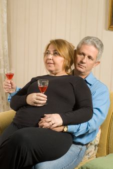Free Women On Lap, Drinking Wine-Vertical Stock Image - 5640741