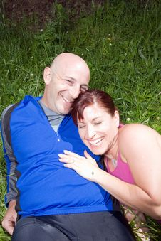 Free Happy Couple On The Grass Laughing - Vertical Royalty Free Stock Photos - 5640758